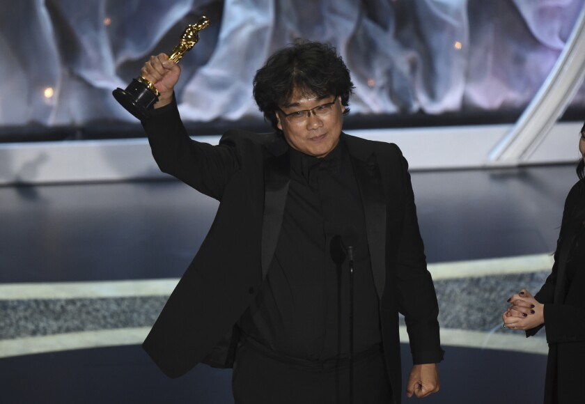 """Bong Joon Ho accepts the award for best international feature film for """"Parasite,"""" from South Korea, at the Oscars on Sunday, Feb. 9, 2020, at the Dolby Theatre in Los Angeles. (AP Photo/Chris Pizzello)"""