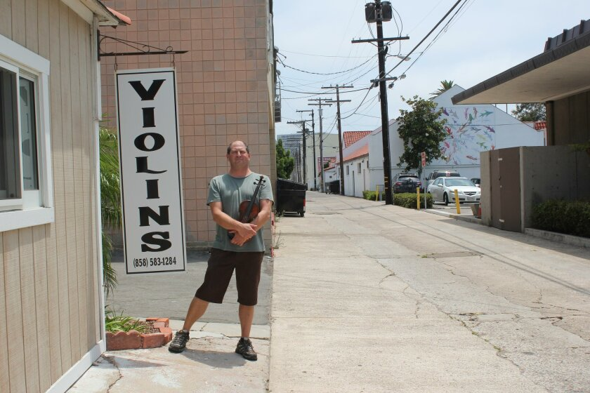 Jade Schultz has fixed and sold violins in La Jolla for 13 years — eight of them in an alley off Silverado Street.