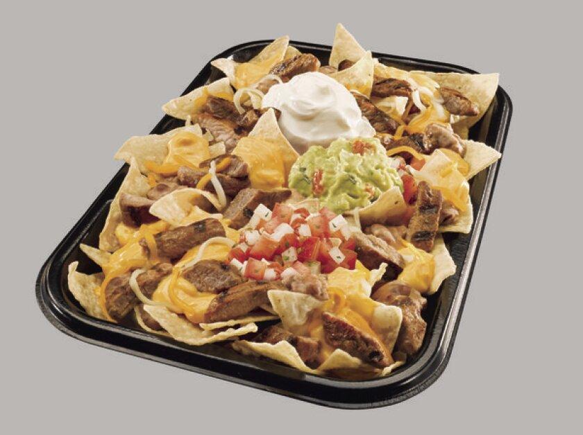 Irvine-based Taco Bell says its new XXL Steak Nachos are 'restaurant-sized nachos.'
