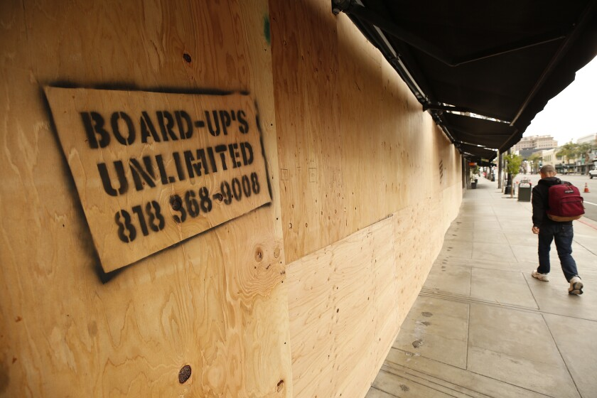 Some stores in Beverly Hills and Pasadena have boarded up the front to prevent vandalism.