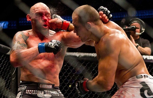 Junior Dos Santos pummels Shane Carwin with an overhand right during their heavyweight bout at UFC 131 on Saturday night in Vancouver, Canada.