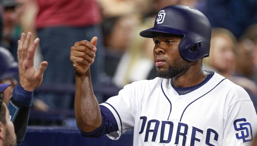 The Padres' Manuel Margot is congratulated after scoring during game against the Rockies at Petco Park in San Diego on Tuesday, May 2, 2017.