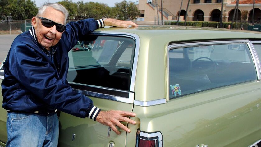 John Hopkins with his newly restored 1969 Country Sedan.