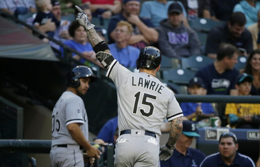 Chicago White Sox' Brett Lawrie points to the stands as he heads to the dugout after hitting a solo home run against the Seattle Mariners in the second inning of a baseball game, Tuesday, July 19, 2016, in Seattle. (AP Photo/Ted S. Warren)
