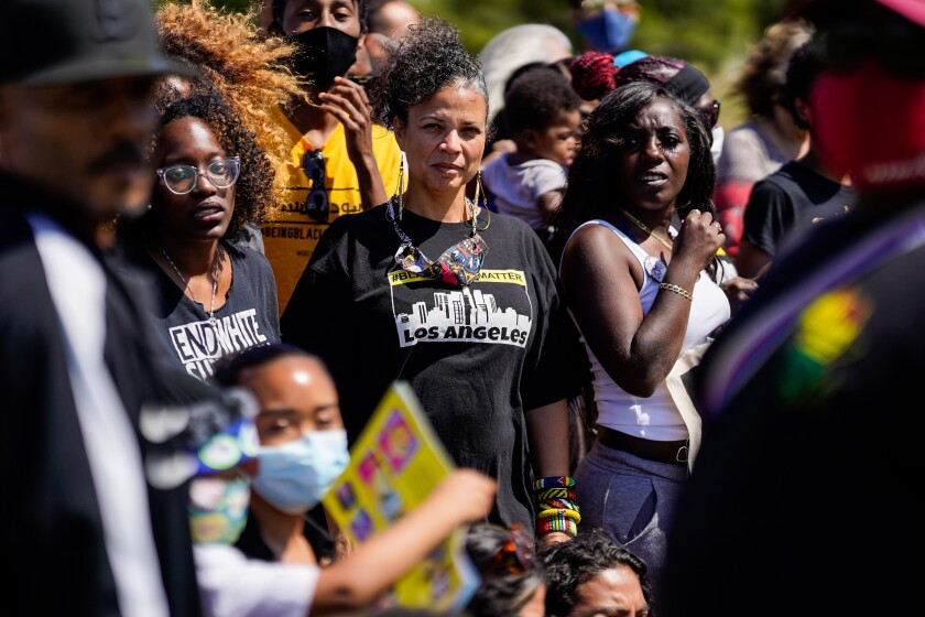 Melina Abdullah stands with other members of Black Lives Matter for a group photo