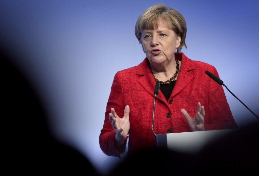 German Chancellor Angela Merkel delivers a speech during a reception of the Federation of German Industries (BDI) in Berlin, Germany, Tuesday, Nov. 3, 2015. (AP Photo/Michael Sohn)