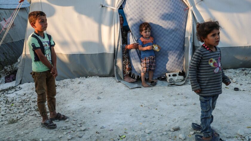 Children at a camp for forcibly displaced people in Latakia, Syria.