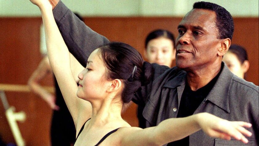 Arthur Mitchell, the artistic director of Dance Theatre of Harlem, coaches a Chinese dancer during an audition held at Beijing Dance Academy in this 2000 file photo.