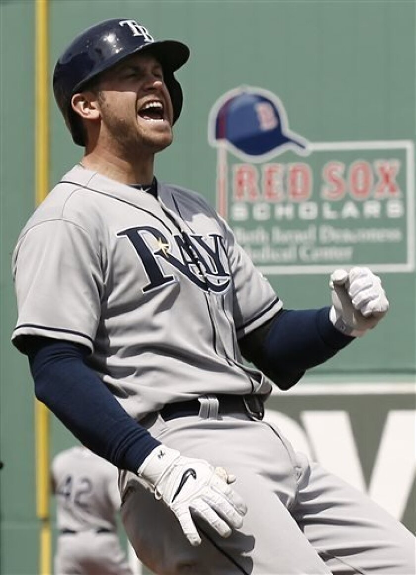 Tampa Bay Rays' Evan Longoria reacts to being called out at first during the sixth inning of their 3-2 loss to the Boston Red Sox in a baseball game at Fenway Park in Boston Monday, April 15, 2013. (AP Photo/Winslow Townson)