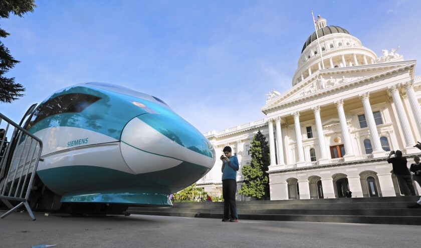 The cost of the L.A. to San Francisco bullet train is politically sensitive. Public opinion polls show that public support has dropped as costs have risen. Above, a full-scale mock-up of a high-speed train displayed in Sacramento in February.