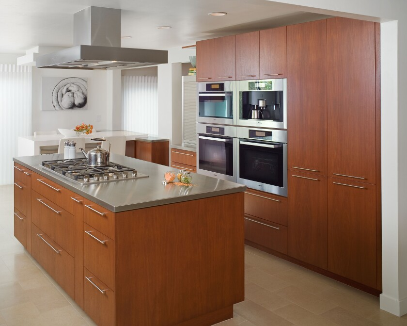 Steel counters can be perfect for families with children.  They don't stain like granite and are easy to clean.