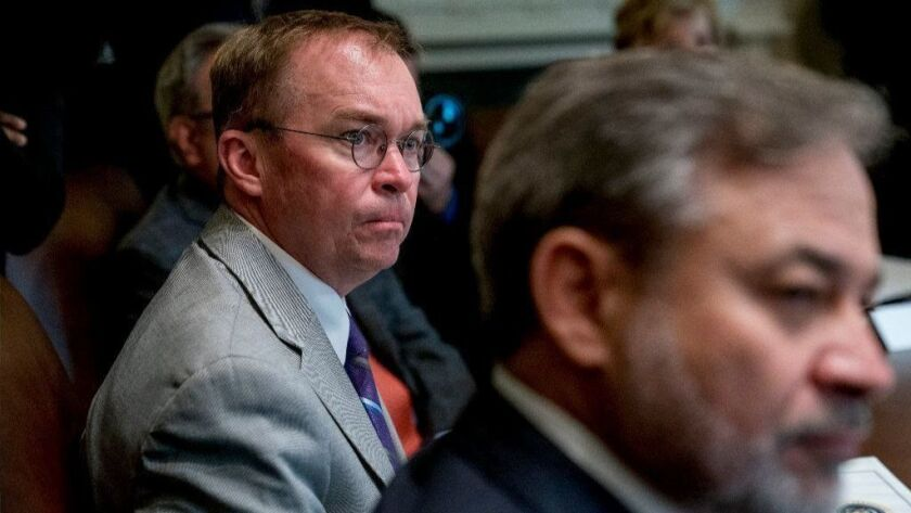 Interim CFPB Director Mick Mulvaney attends a Cabinet meeting at the White House last month.