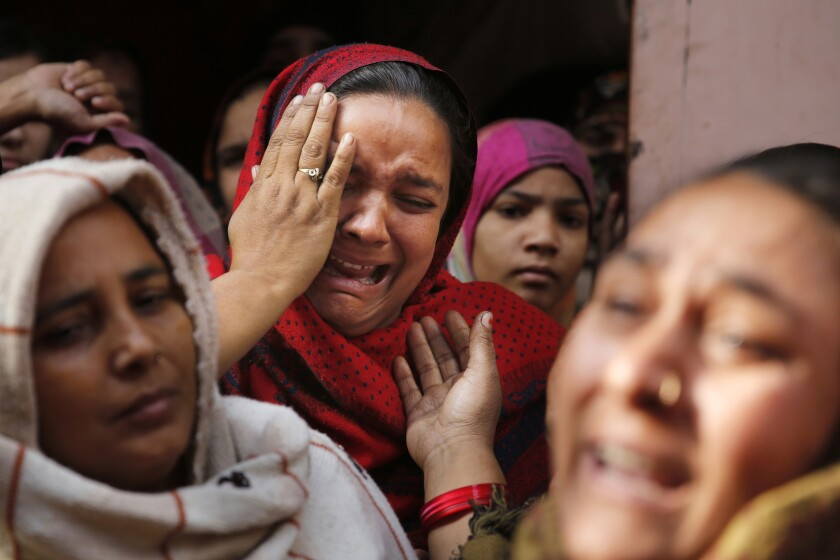In this Tuesday, Dec. 24, 2019, photo, sister of Mohsin Ahmad, a laborer who was shot and killed allegedly in police firing during protests against Citizenship Amendment Act, cries outside her residence in Meerut, India. Tens of thousands of people have taken to the streets to oppose a new law that grants a path to citizenship for immigrants of every religion except Islam. Many say the law, passed by Prime Minister Narendra Modi's Hindu-nationalist government, discriminates against Muslims and undermines the country's secular foundations. (AP Photo/Rajesh Kumar Singh)