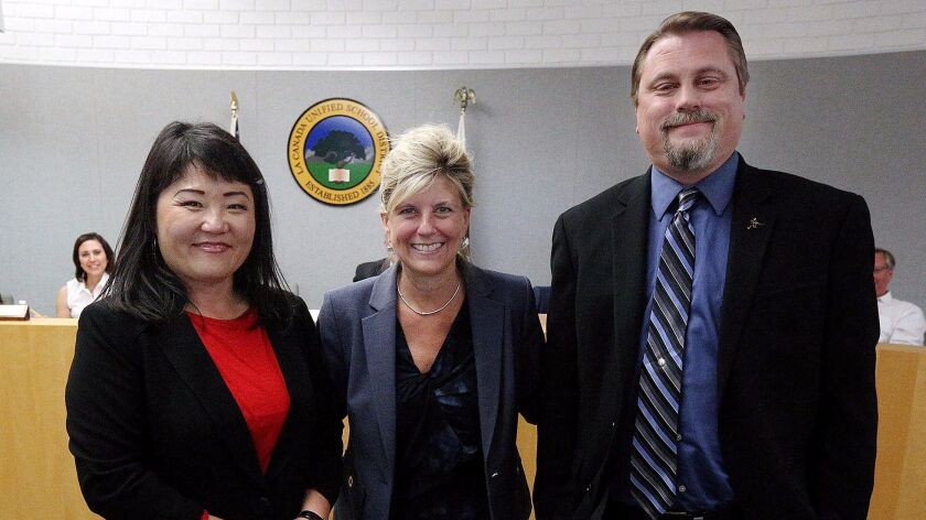 LCUSD Supt. Wendy Sinnette stands between newly approved La Cañada High School assistant principals