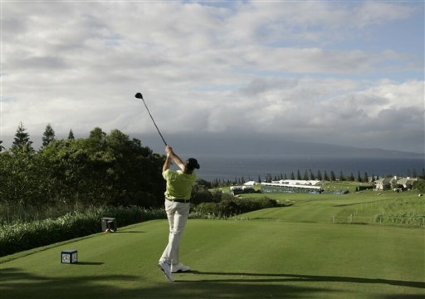 Geoff Ogilvy, of Australia, hits from the 18th tee of the Plantation Course during the first round of the Mercedes-Benz Championship golf tournament in Kapalua, Hawaii, Thursday, Jan. 8, 2009. (AP Photo/Eric Risberg)