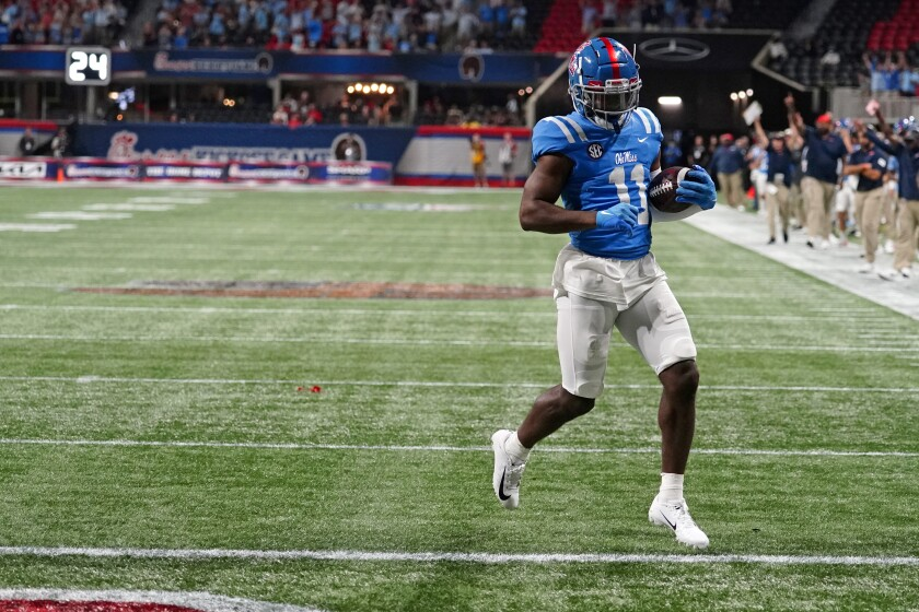 Mississippi wide receiver Dontario Drummond (11) scores after making a catch during the second half of an NCAA college football game against Louisville Monday, Sept. 6, 2021, in Atlanta. (AP Photo/John Bazemore)