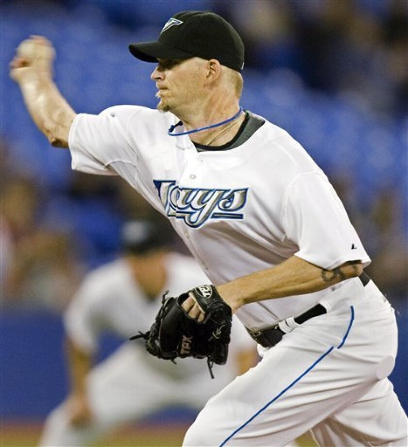 Toronto Blue Jays starting pitcher A.J. Burnett throws during the second inning of a baseball game against the Toronto Blue Jays in Toronto Thursday May 22, 2008. (AP Photo/The Canadian Press, Frank Gunn)
