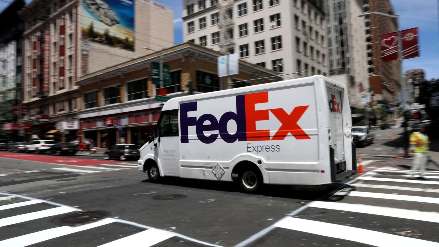 FedEx, embroiled in U S -China trade war, sues Trump administration