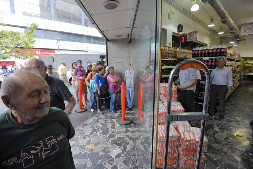 People line up for soap in Caracas, Venezuela, in February.