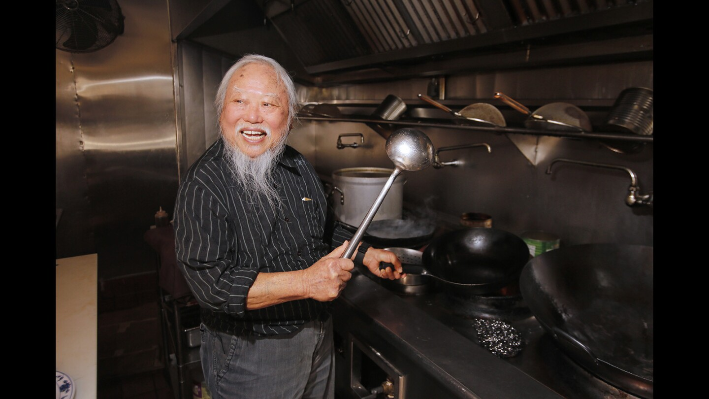 Cheong Kwon Lee laughs as he takes his former chef position at Shanghai Pine Gardens on Balboa island. Mr. Lee retired about 30 years ago and was recently inducted into the historical society of Balboa Island.
