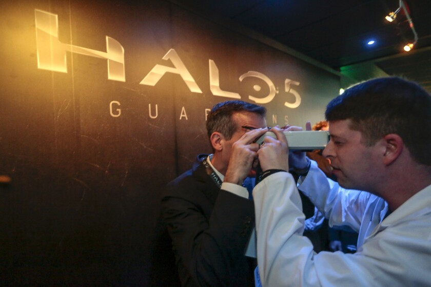 """L.A. Mayor Eric Garcetti has his eyes measured before entering """"Halo 5: Guardians,"""" a virtual experience at the Microsoft Xbox exhibit at E3 in the Los Angeles Convention Center."""