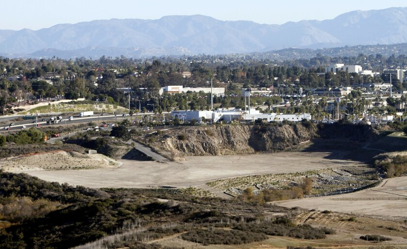 A proposal to put 656 homes on the former Quarry Creek mining property has pitted preservationists against a developer and Carlsbad officials who want to complete a citywide housing plan.