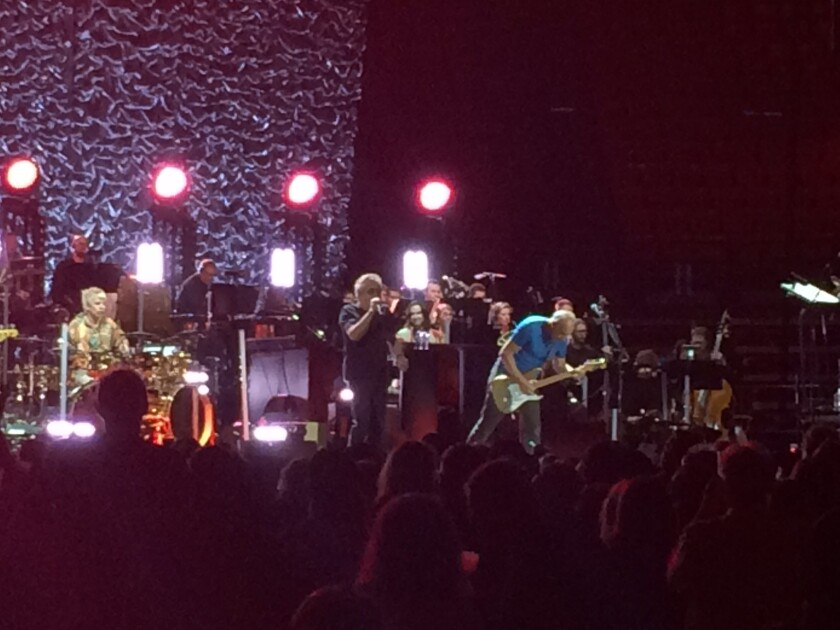 The Who are shown in action at the band's Wednesday night Viejas Arena concert, at which the group was accompanied by a 51-piece orchestra.