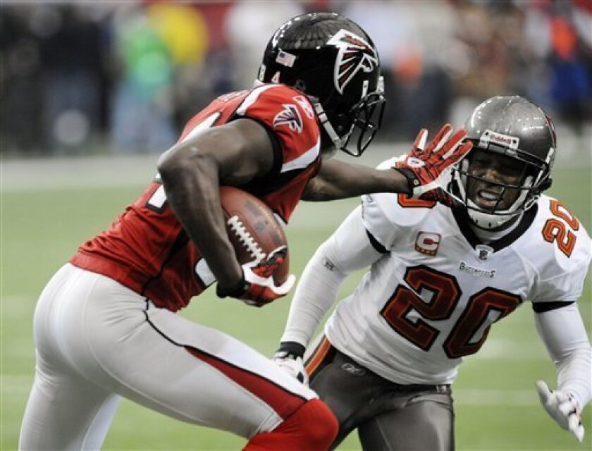 Atlanta Falcons wide receiver Roddy White (84) runs as Tampa Bay Buccaneers cornerback Ronde Barber (20) defends during the first quarter of an NFL football game, Sunday, Nov. 7, 2010, at Atlanta. (AP Photo/Mike Stewart)