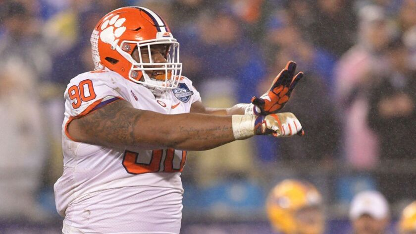 Dexter Lawrence (90) of the Clemson Tigers reacts against the Pittsburgh Panthers in the first quarter during their game at Bank of America Stadium on December 1, 2018 in Charlotte, North Carolina.