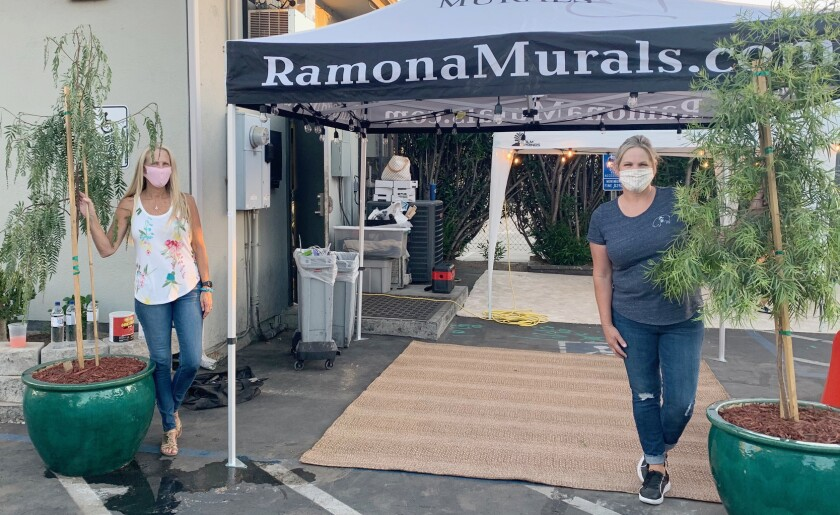 Sandy Sheldon, left, and Katie Suesens joined a patio work party at Marinade on Main.