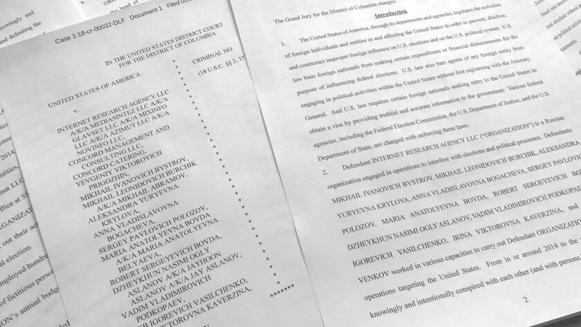 In this March 15, 2018, photo, a portion of the Feb. 16, indictment against Russia's Internet Resear