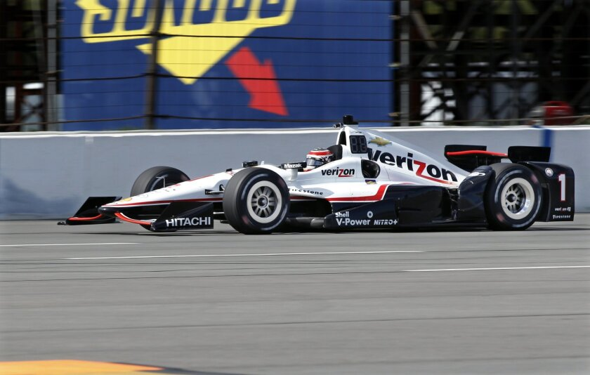Will Power, of Australia, (1) drives during practice for Sunday's Pocono IndyCar 500 auto race Saturday, Aug. 22, 2015, in Long Pond, Pa. (AP Photo/Mel Evans)