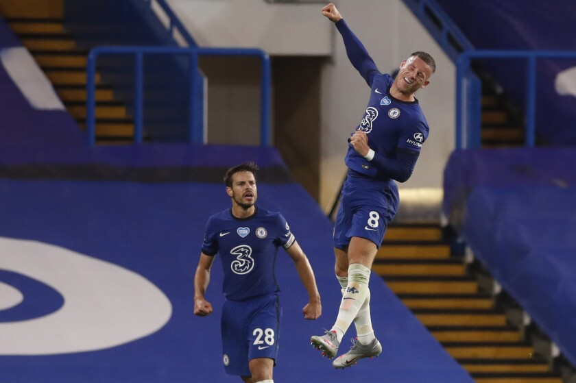 Chelsea's Ross Barkley, right, celebrates after scoring his side's third goal during the English Premier League soccer match between Chelsea and Watford at the Stamford Bridge stadium in London, Saturday, July 4, 2020. (Matthew Childs/Pool via AP)