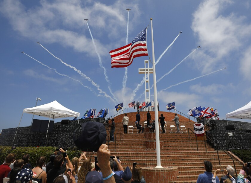 The San Diego Salute Formation Team flies over the Memorial Day Ceremony at Mt. Soledad National Veterans Memorial.