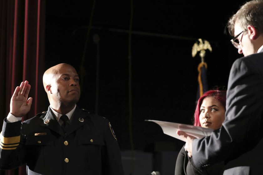 FILE - In this Sept. 8, 2017, file photo, newly appointed Minneapolis Police Chief Medaria Arradondo takes the oath of office as his daughter Nyasia looks on during a public swearing-in ceremony, in Minneapolis. George Floyd's death and the protests it ignited nationwide over racial injustice and police brutality have raised questions about whether Arradondo — or any chief — can fix a department that's now facing a civil rights investigation. (Anthony Souffle/Star Tribune via AP, File)