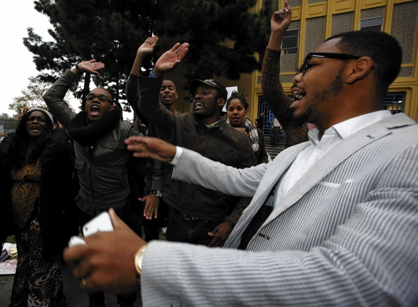 Cecil Thompson, right, and other former students present a musical tribute to their teacher Iris Stevenson in front of Crenshaw High School in Los Angeles. Stevenson, the school's longtime and well-known choir director, was removed from the classroom in December and has been assigned to L.A. Unified offices pending an investigation of unspecified allegations.