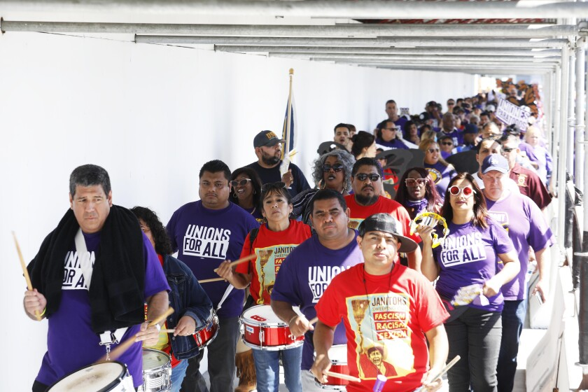 Workers marched through LAX last month for better pay and benefits.