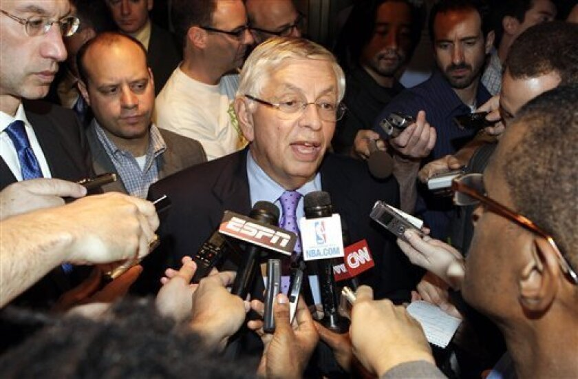 NBA Commissioner David Stern, center, talks with reporters after leaving an NBA labor talks meeting , Monday, Oct. 10, 2011, in New York. Stern canceled the first two weeks of the season after players and owners were unable to reach a new labor deal to end the lockout. At left is Deputy Commissioner Adam Silver. Opening night was scheduled for Nov. 1. (AP Photo/David Karp)