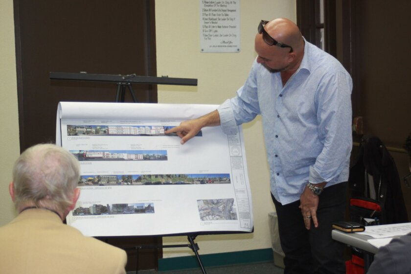 Claude-Anthony Marengo shows the scale for his proposed project — a mixed use facility at 6738 — in relation to neighboring buildings.