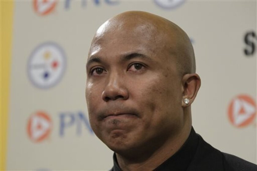 Former Pittsburgh Steelers receiver Hines Ward listens to a question after announcing his retirement from the NFL at the Steeler's offices in Pittsburgh Tuesday, March 20, 2012. Joshua Van Auker, 26, who pleaded guilty to trying to extort $15,000 from the former Pittsburgh Steelers receiver will sp