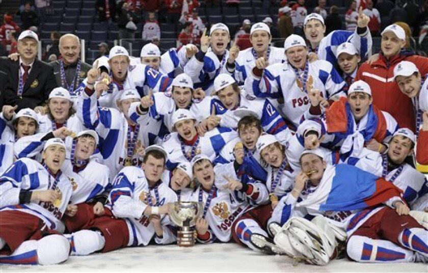 Members of Team Russia pose for a group photo with their gold medal following their 5-3 victory over Team Canada in the IIHF World Junior Championship gold medal final hockey action in Buffalo, N.Y. on Wednesday, Jan. 5, 2011. (AP Photo/The Canadian Press, Nathan Denette)