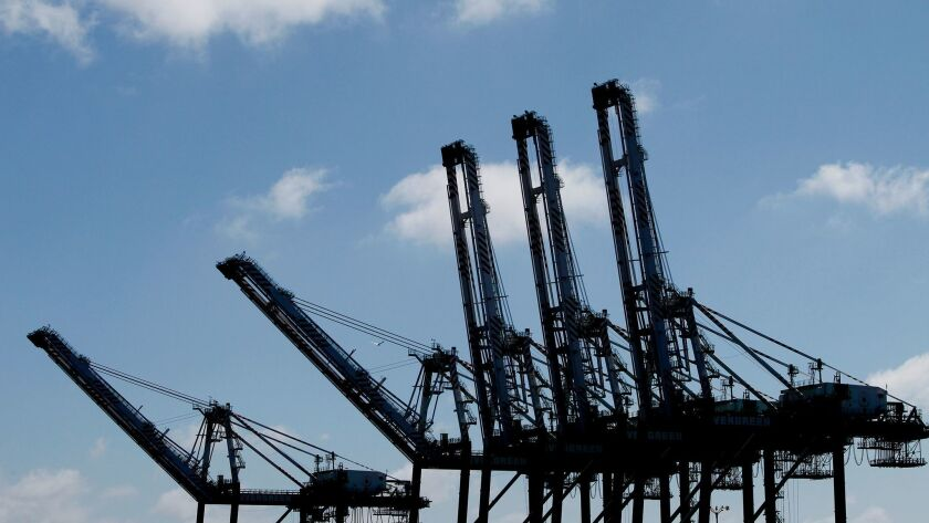 Giant cranes stand ready in the Port of Los Angeles to load and unload container vessels.
