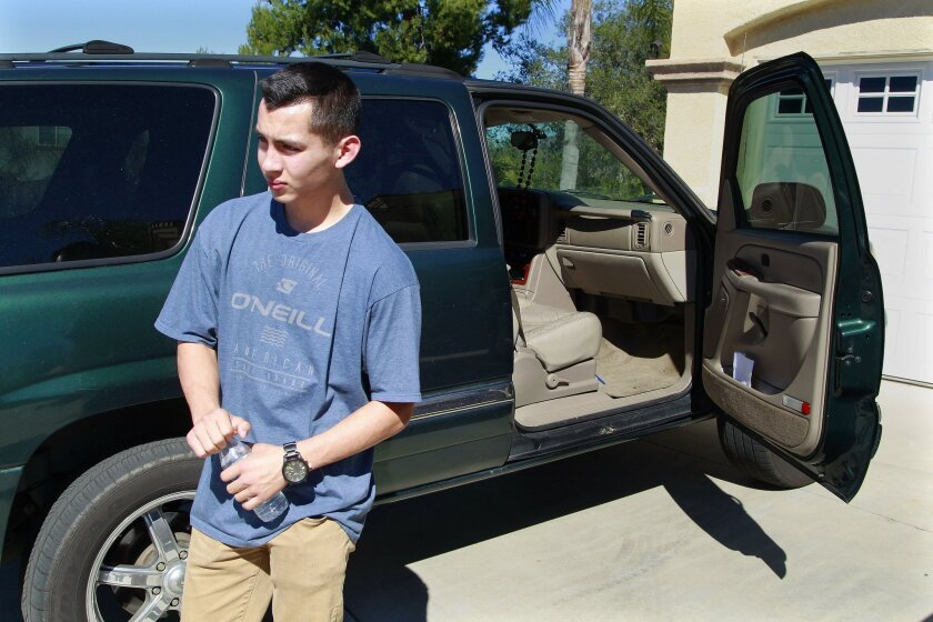 SAN DIEGO, CA February 9, 2016 : | Sam Serrato stand in from of his car on Tuesday in Escondido, California. Serrato is facing expulsion from San Pasqual High School under a zero tolerance policy that says students can't bring a knife to campus under any circumstances. | (Eduardo Contreras / San Di