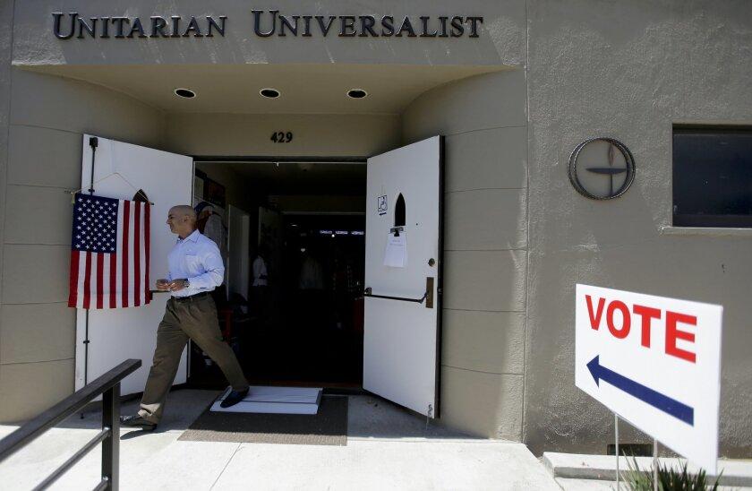 California Republican gubernatorial candidate, Neel Kashkari leaves after dropping off his ballot at his polling place Tuesday, June 3, 2014 in Laguna Beach, Calif. (AP Photo/Chris Carlson)
