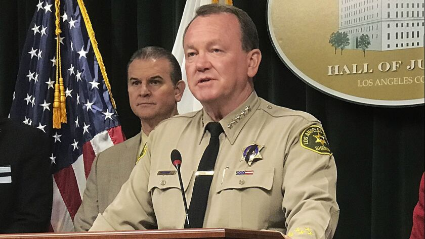FILE--In this June 27, 2018, file photo, Los Angeles County Sheriff Jim McDonnell talks to reporters
