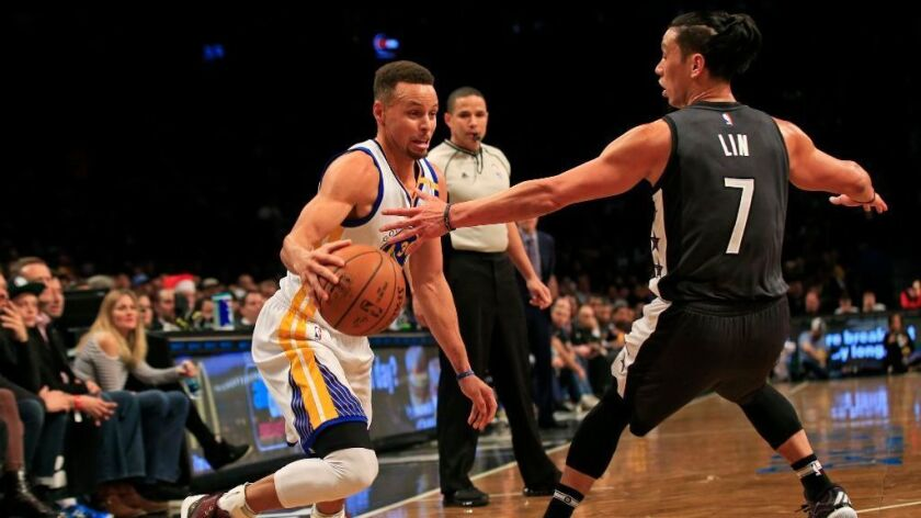 Golden State Warriors guard Stephen Curry drives to the basket past Brooklyn Nets guard Jeremy Lin during the second half of a game on Dec. 22.