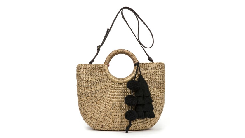 The Basket S bag by JadeTribe doubles as both a hand-held tote and a cross-body bag, making it a ver