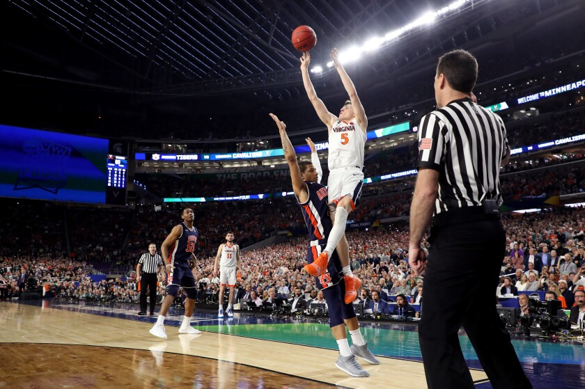 Virginia's Kyle Guy attempts a game-winning shot as he is fouled by Auburn's Samir Doughty in the final second of their semifinal at U.S. Bank Stadium in Minneapolis.