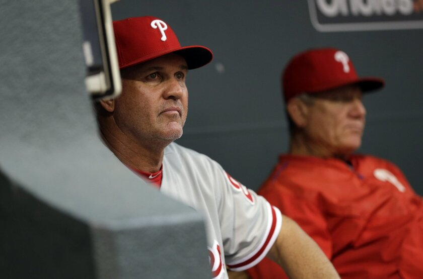 Philadelphia Phillies manager Ryne Sandberg, left, watches from the dugout in the fourth inning of an interleague baseball game against the Baltimore Orioles, Monday, June 15, 2015, in Baltimore. (AP Photo/Patrick Semansky)