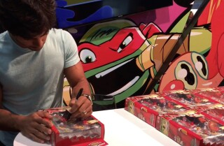 Brennan Mejia, Red Dino Charge Ranger, signs at Comic-Con 2015